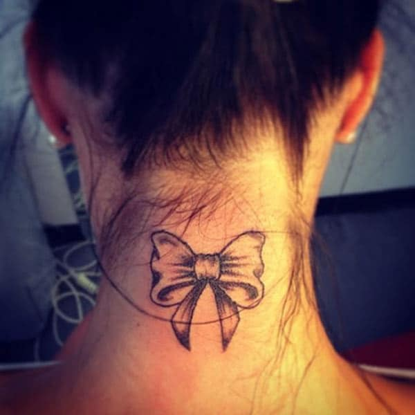 The blue ink mix design bow tattoo on the back of the neck make girls attractive