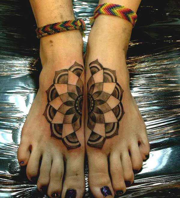 Foot Tattoo for girls with a black flower design make them look ornate