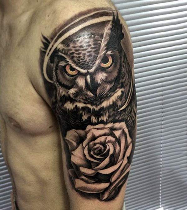 Half Sleeve Tattoo on the left shoulder makes men appear stately