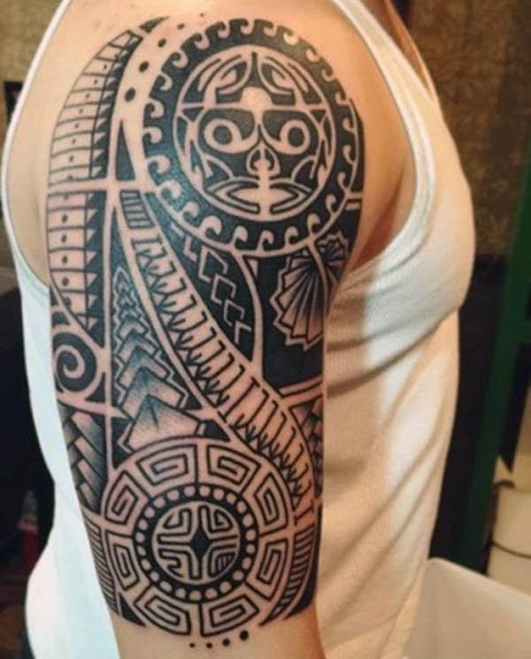 Half Sleeve Tattoo on the right upper arm make a man look stylish