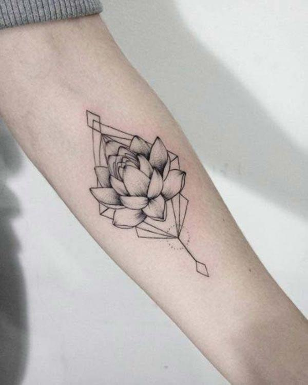Lotus Flower tattoo on the lower arm brings the feminist look