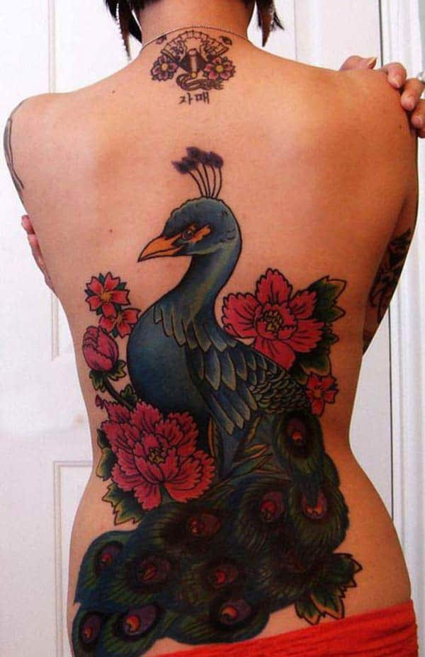 Peacock Tattoo at the back makes a woman appear stylish