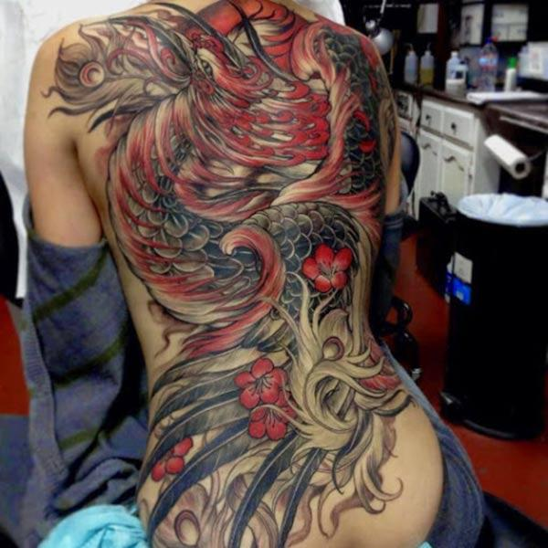 The Phoenix tattoo on the back with a pink ink design, make girls have splendid look
