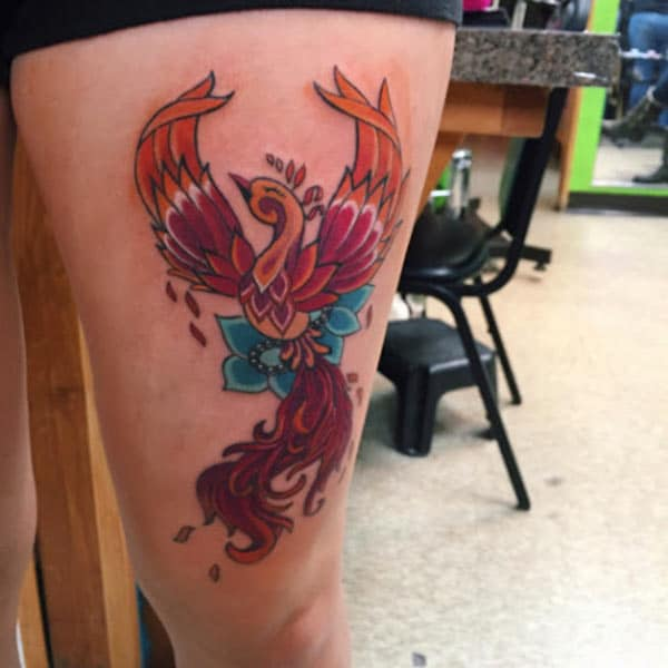 Phoenix tattoo on the side thigh gives the girls an attractive look