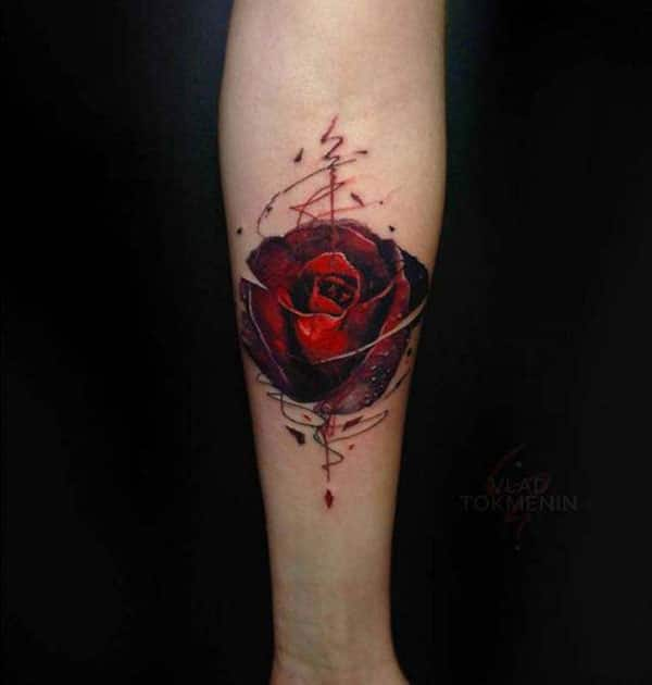 Rose tattoo on the lower arm makes a woman look captivating