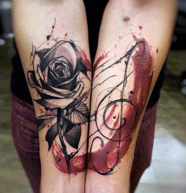 Rose tattoo on the lower arm brings the astonishing look