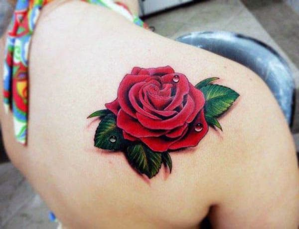 Rose tattoo on the back should make a lady look captivating