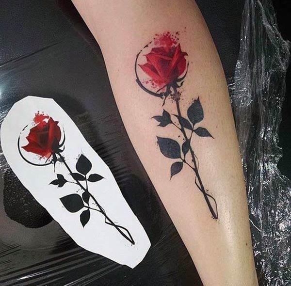 Rose tattoo on the lower arm make a girl appear stunning