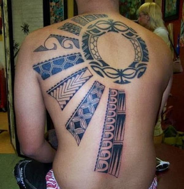Tribal tattoo on the back make a man look cute