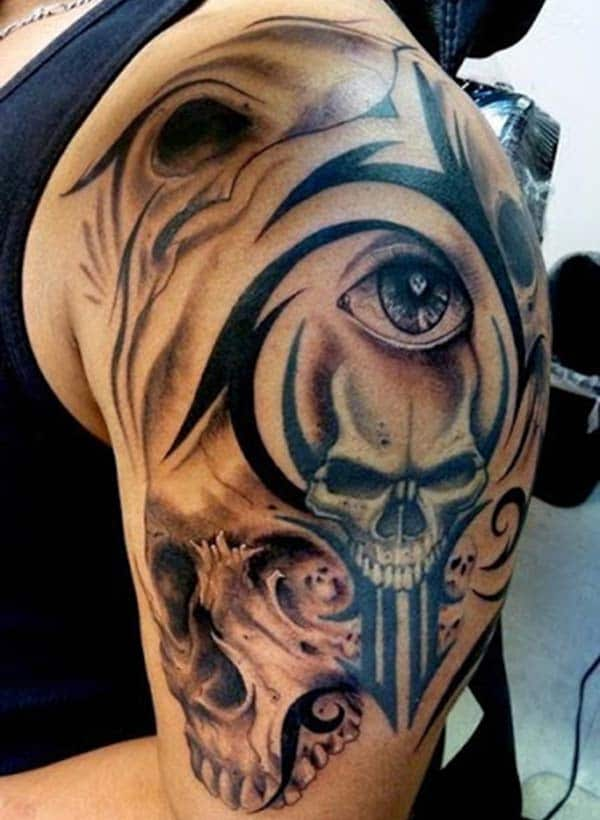 Tribal tattoo with a black and brown design ink makes a man look attractive