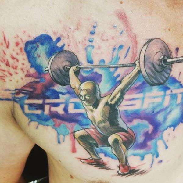 Radiant and spirited Weight lifting Watercolor cool chest tattoo ideas for male work out addicts