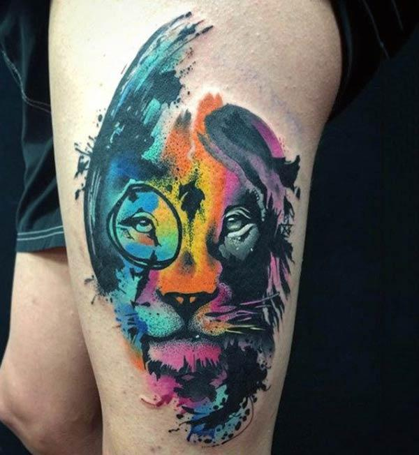 Intense colored majestic lion face with dreamy eyes watercolor thigh tattoo ideas for Females