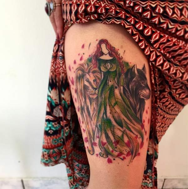 Beguiling watercolor thigh tattoo of lady with lion and lop on either side for Women