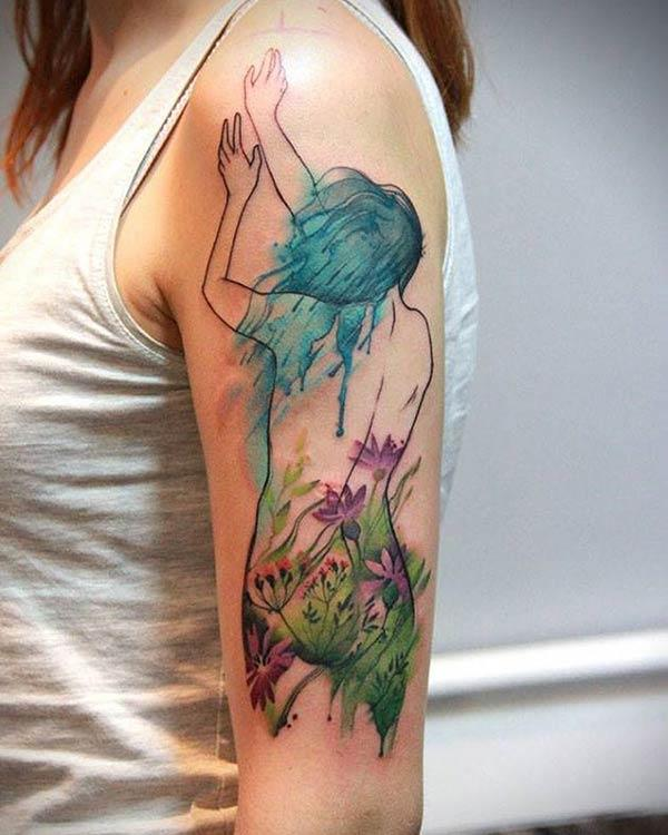 Girl covered with flowers watercolor tattoo on arm for women