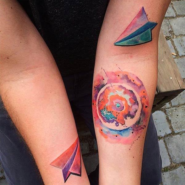 Cool attractive earth paper plane watercolor tattoo designs on arm for young ladies