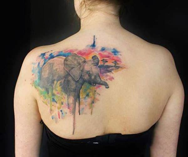 Breathtaking beautiful elephant at sunset watercolor tattoo on back shoulder for ladies