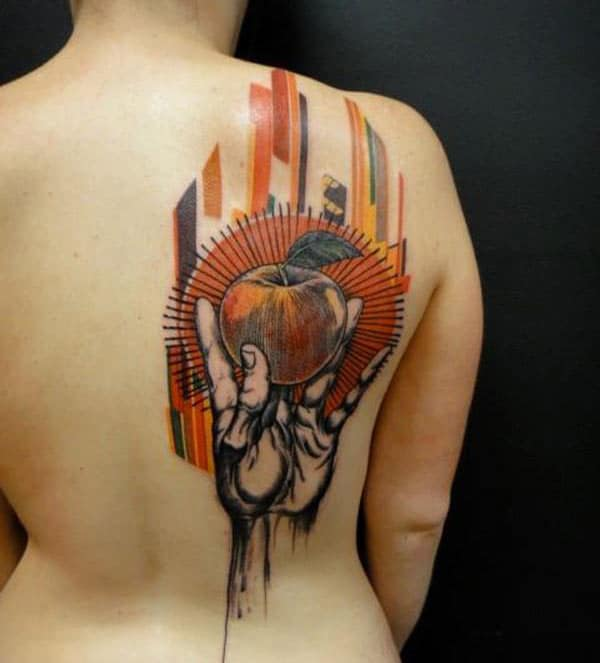Jaw dropping bulb shaped hand holding apple tattoo ideas on back shoulder for Ladies