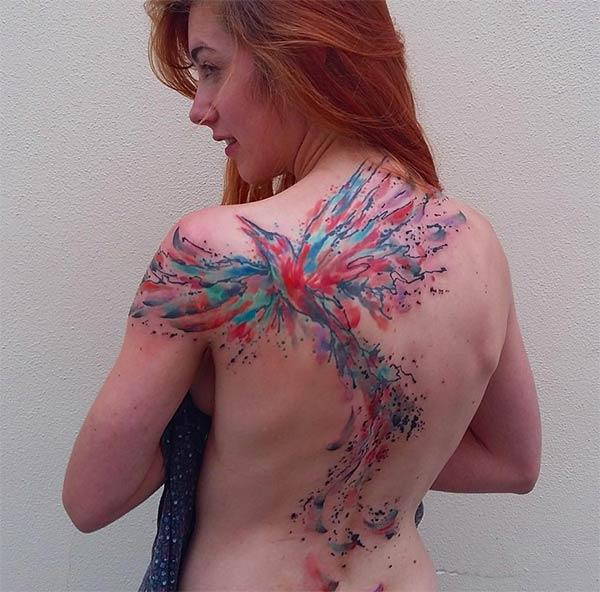 Majestic bright colored Flying bird watercolor back tattoo ink ideas para Ladies