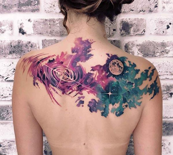 Captivating galaxy planet watercolor back tattoo ideas for Females