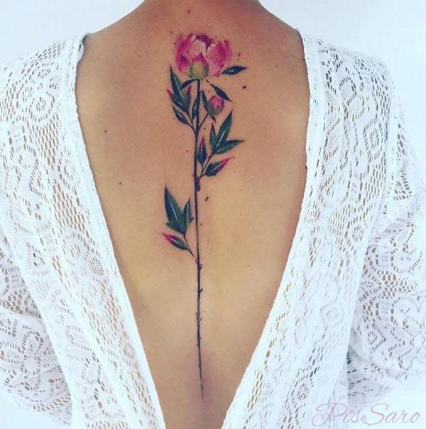 Simple elegant long stalked Flower watercolor back tattoo ideas for Girls
