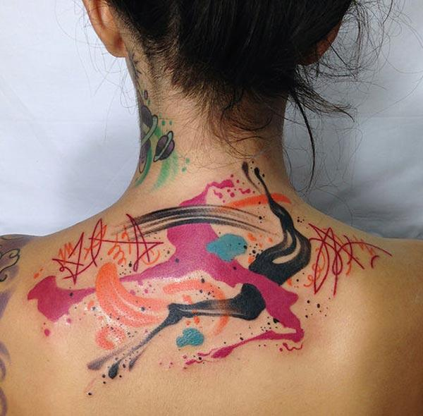 Awesome multicolor ink art watercolor tattoo on back for Trendy Girls