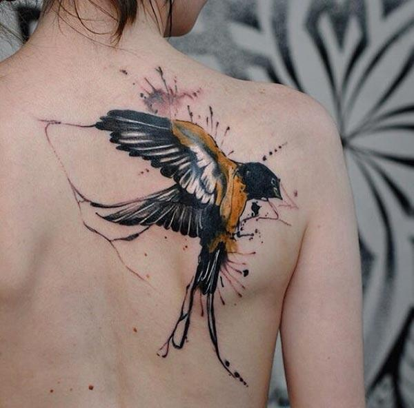 Fantastic catchy flying black golden bird watercolor tattoo ink ideas on back shoulder for chic style Girls