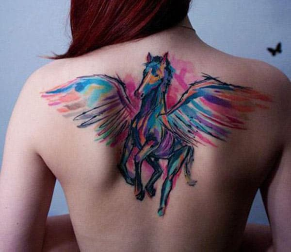 Multi colored majestic horse with wings tattoo on the back for trendy Women