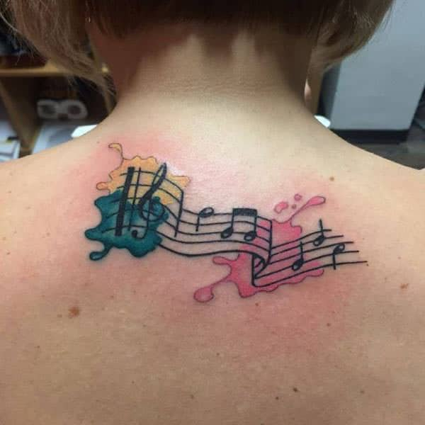 Musical notes on green yellow pink ink splash tattoo ideas on back for Female music enthusiasts