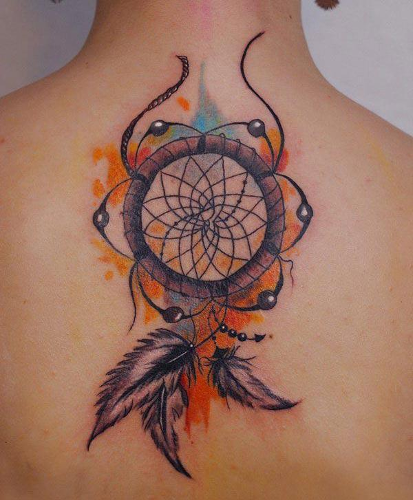 Beguiling realistic dream catcher tattoo ideas for ambitious women on back