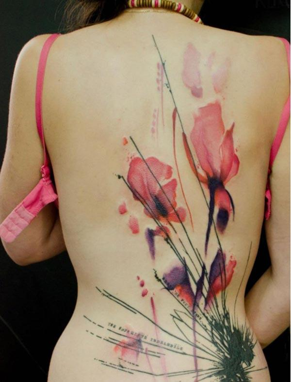 Back tattoo ideas na kyawawan Flowers tare da wordsings a kan stalk ga Girl