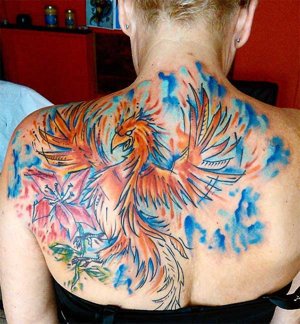 Striking flamboyant flying bird flower back tattoo ideas for Ladies