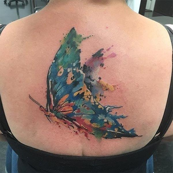 Deep colored coloured butterfly back tattoo designs for girls and women