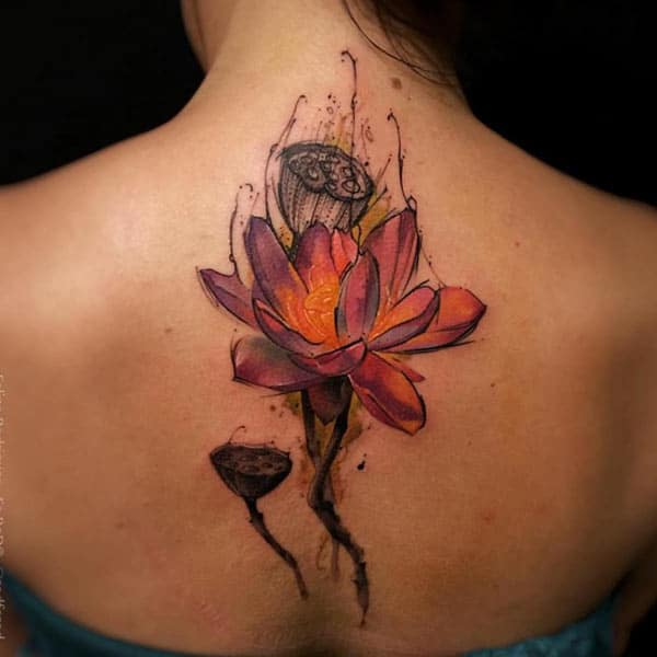 Garish flower with buds back tattoo design for fashionable girls