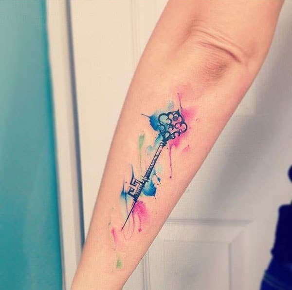 Winsome elegant skeleton key watercolor forearm tattoo for trendy women