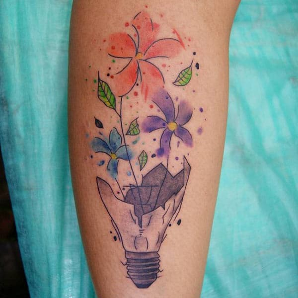 Elegant bright colored flowers bloomed in broken bulb tattoo ideas on forearm for Girls