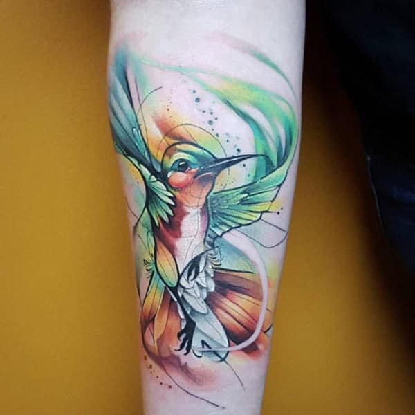Captivating Vibrant humming bird watercolor forearm tattoo ideas for Ladies