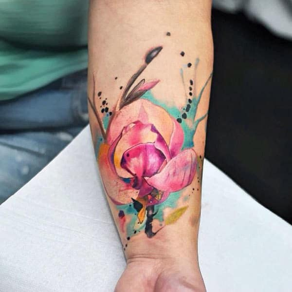 Multicolored flower watercolor tattoo on forearm for Girls and women