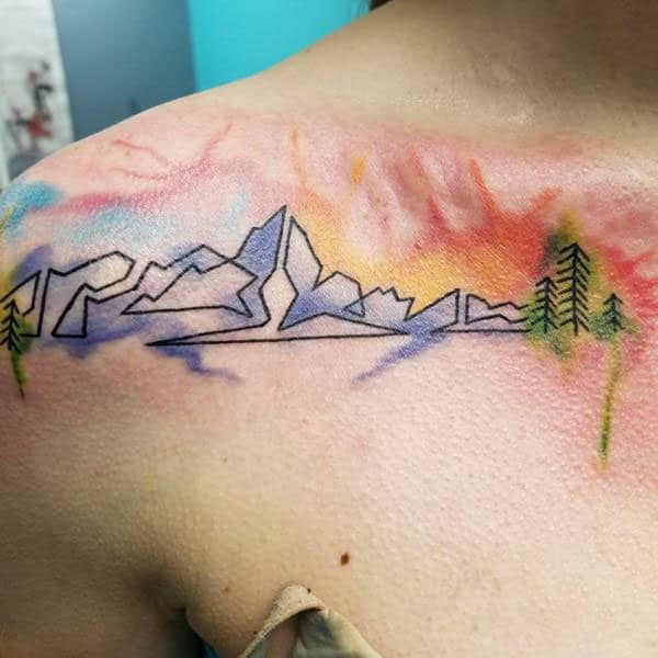 Bright colored continuous line mountains trees watercolor tattoo ideas on front shoulder for daredevil women