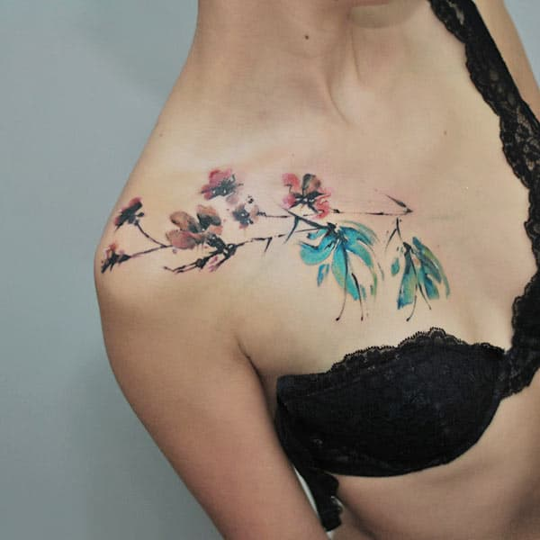 Mesmerizing Cherry blossom watercolor tattoo designs on front shoulder for girls and women
