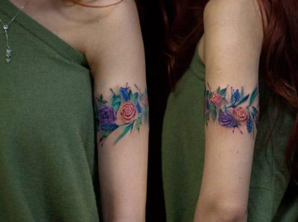 Ornamental floral watercolor tattoo designs on hand for fashionable girls