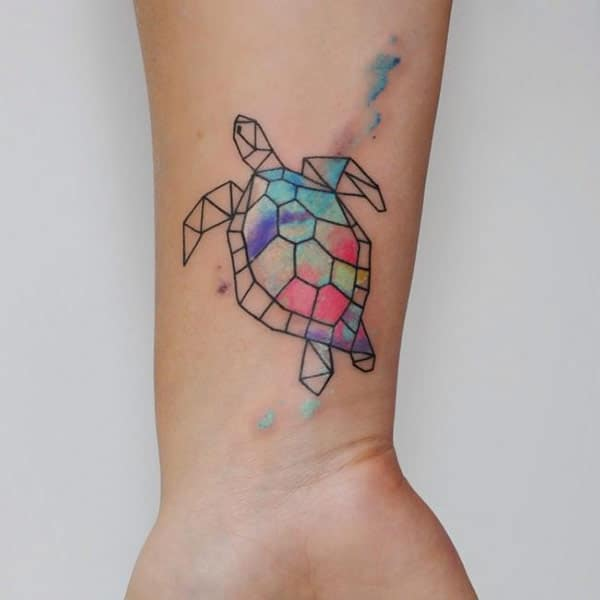 Women's Graceful geometric turtle watercolor hand tattoo