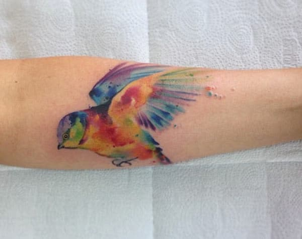 Vivid colored flying bird hand tattoo designs for adventurous Girls