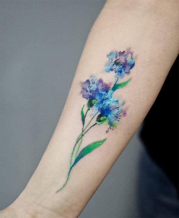 Alluring blue purple flowers watercolor hand tattoo ideas for fashionable girls