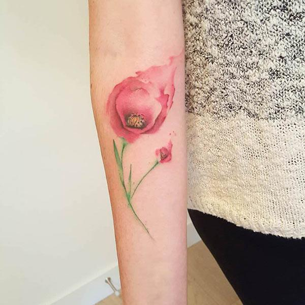Ink spread red flower with bud tattoo on hand for Female
