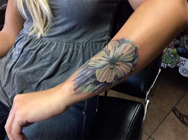 Intense deep colored huge flower tattoo design on hand for Ladies