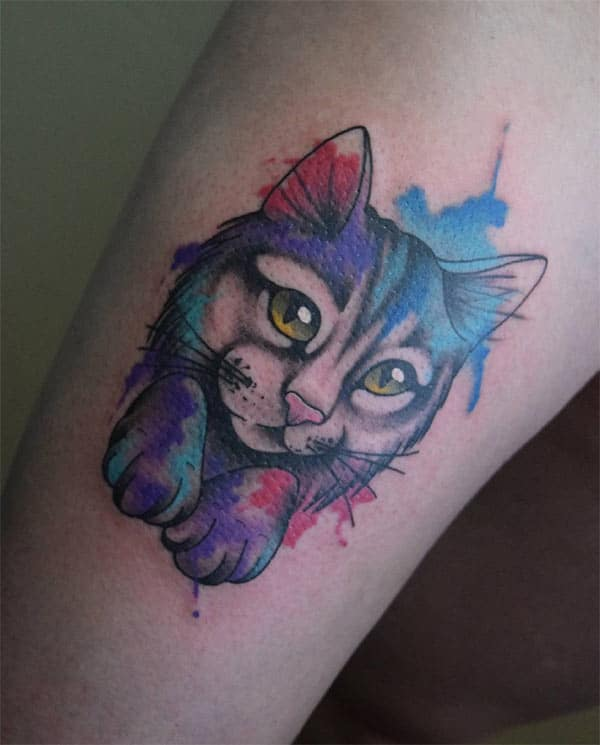 Adorable rich colored kitten watercolor tattoo on hands for feline loving Women