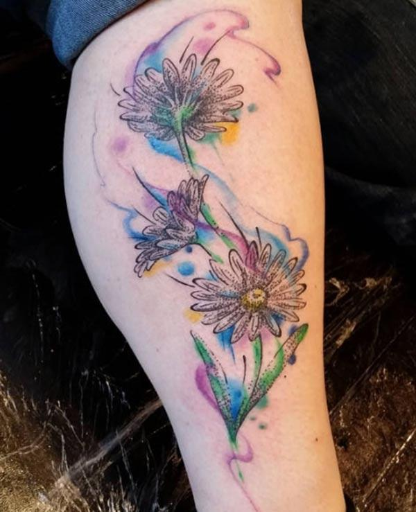 Pretty daisies dancing in wind watercolor tattoo ideas on legs for girls