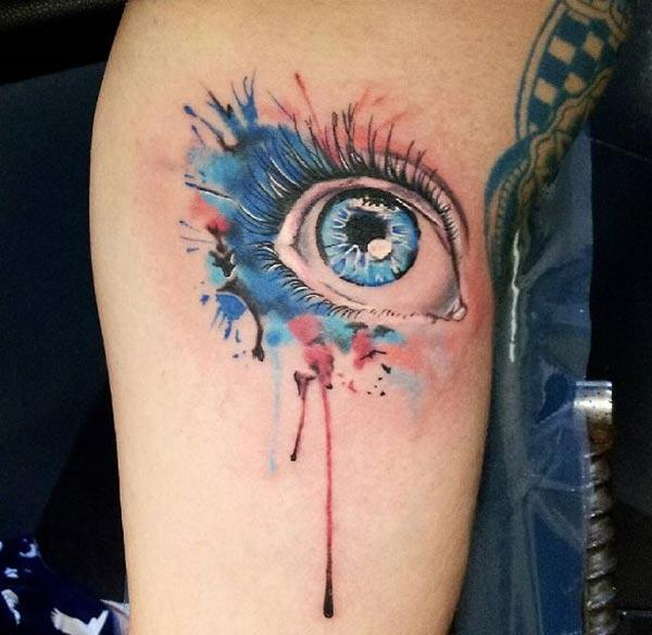 Fascinating dreamy eyes watercolor leg tattoo designs for Females