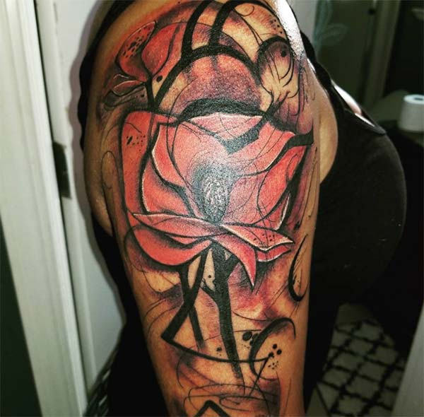 Arresting watercolor shoulder tattoo design of black red rose for trendy Females