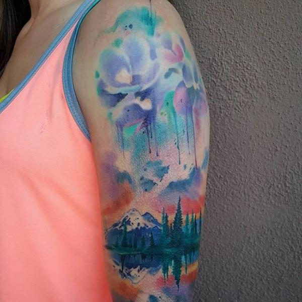 Spectacular watercolor tattoo design of scenery on shoulder for Adventurous women